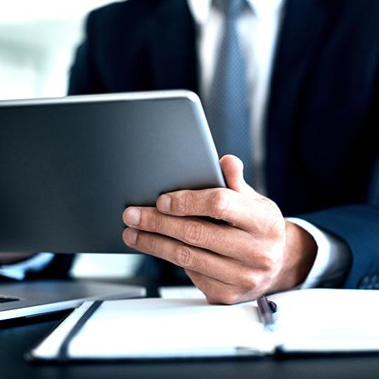 close up of businessman using tablet